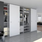 System with Continuous Bottom Guide Profile for Room-Height Sliding Doors. HAWA-Ordena 70/F